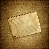 Vintage envelop on brown canvas Stock Photos