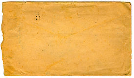 Vintage envelope. A background with a view of a vintage yellow envelope, isolated on a white background Stock Image