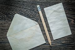 Vintage envelope clean paper sheets pencil on black board Stock Photo