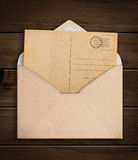 Vintage envelope with paper. Stock Photo