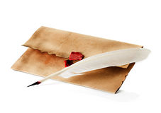 Vintage envelope and quill pen. Old, vintage envelope and quill pen isolated stock image