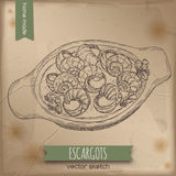 Vintage escargots dish sketch placed on old paper background. Stock Photo