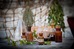 Vintage essential oils. Old bottles of essential oils for making soap in a traditional market. Shallow DOF Royalty Free Stock Photos