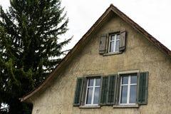 Vintage european hosue with tree. And windows stock photos