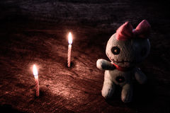 Vintage evil spooky doll with light of candle Royalty Free Stock Images