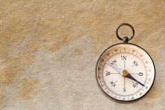Vintage exploration compass, navigator. Compass, navigator macro view. Manuscript aged paper background. copy space Royalty Free Stock Image