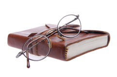 Vintage Eyeglasses and Leather Journal Royalty Free Stock Photos