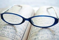 Vintage eyeglasses on old blur Arabic book (Ramadan season) Stock Photography