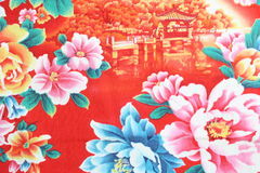 Vintage fabric detail. Closeup of retro tapestry fabric pattern with multi-colored floral ornament on red background Stock Image
