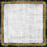 Vintage Fabric Grunge. Decorative old fashioned retro style background design with border on a grunge fabric in brown and gray tones stock illustration