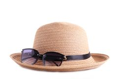 Vintage fabricate straw hat and sunglasses isolated on white background stock photo