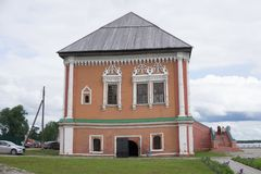 Vintage facade of a brick dand wooden two-storey house in traditional Russian style. Front view colse up. stock photography