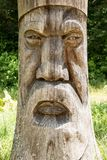 Vintage face carved in wood Royalty Free Stock Photo