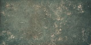 Vintage Faded old green paper Background Texture. Vintage Faded old green paper Background. Grunge Shabby paper Texture. Worn paper Surface. Wide angle Wallpaper stock photos