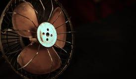 Vintage fan. On a black background Stock Image