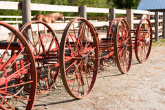 Vintage farm equipement wheels Royalty Free Stock Photos