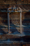 Vintage farm implement. Antique farm tool hanging on a weathered barn wall Royalty Free Stock Photos