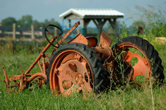 Vintage Farm Plow. A rusty old farm plow sits as a decoration in a field in the hills of Kentucky, USA royalty free stock images