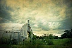 Vintage Farm Scene. A farm scene with a stormy sky above with an aged feel Stock Photos