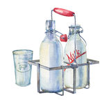 Vintage farmhouse kitchen metal holder rack with bottles of milk and glass of milk. Stock Photo