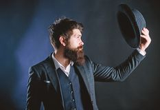 Vintage fashion. Man well groomed bearded gentleman on dark background. Male fashion and menswear. Formal suit classic. Style outfit. Elegant and stylish stock photos