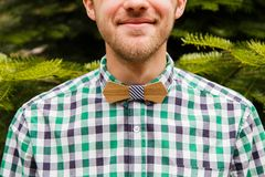 Vintage fashion man with wooden bowtie Stock Image