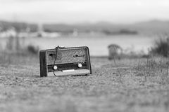 Vintage fashioned old radio on the beach Stock Photos