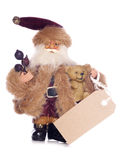Vintage father christmas ornament with brown gift tag Stock Image