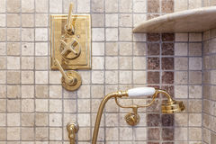 Vintage faucet and shower. Gold color in bath. Royalty Free Stock Photos
