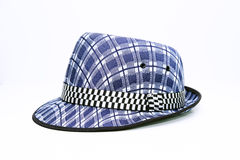 Vintage, felt trilby/fedora hat with plaid blue pattern on a white background. Royalty Free Stock Photography