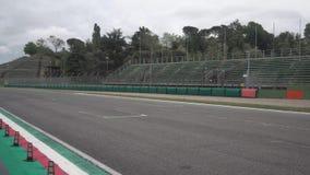 Imola, Italy 28 April 2019: Vintage Ferrari F1 is racing on the main straight stock video footage