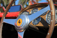 Vintage Ferrari racer steering wheel and cockpit. Classic steering wheel and instrument panel in background.  classic italian racing car at 2013 cavallino Stock Images
