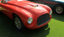Vintage ferrari sports car headlamps and grill. Vintage 1949 ferrari 166 mm bachetta by touring sports car showing frontend headlamps and grill Stock Photos