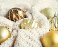 Vintage festive golden Christmas globes in woolen blanket with l. Ights Royalty Free Stock Image