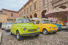 Vintage Fiat 500 Lombardi and Abarth. Vintage italian car Fiat 500 Francis Lombardi and Abarth near a carousel in classic cars rally during the feast Sagra dei royalty free stock photo