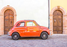 Vintage Fiat 500. RIMINI,ITALY - MAY 17,2014: Fiat 500 car on the street. Fiat 500 is among Top 50 cars in automotive history. Nowadays it is desired by Stock Photography