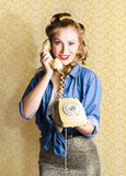 Vintage Fifties Telephone Operator Holding Phone. Fifties Classic Portrait Of A Vintage Woman Talking On The Old Fashioned Yellow Phone Stock Photo