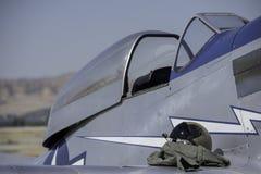 Vintage fighter pilot's helmet and cockpit. Royalty Free Stock Images