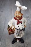 Vintage figurine: French chef. Vintage figurine: French head-cook Stock Image