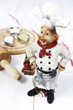 Vintage figurine: French chef, rolling pin, baking cup with flou Royalty Free Stock Image