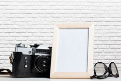 Vintage film camera and blank photo frame Royalty Free Stock Photography