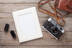 Vintage film camera and blank photo frame Stock Images