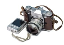 Vintage film camera and compact digital camera. White background royalty free stock photography