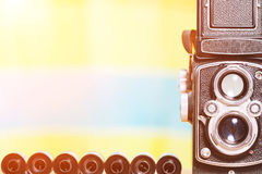 Vintage film camera and film roll with copy space in retro color Royalty Free Stock Photo