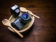 Vintage film camera with flash set on dish for food Royalty Free Stock Photos