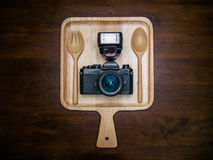 Vintage film camera with flash set on dish for food Stock Photo