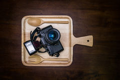 Vintage film camera with flash set on dish for food Royalty Free Stock Image