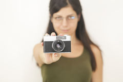 Vintage film camera hold by pretty young woman Stock Photo