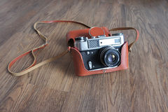 Vintage film camera in leather case Royalty Free Stock Photography