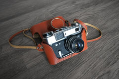 Vintage film camera in leather case Royalty Free Stock Image